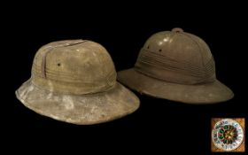 Two Early 20thC Khaki Covered Expedition Hats with silk lined interior. A/F