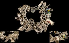 A Vintage Silver Bracelet Loaded with Approx 40 Silver Charms - Both Bracelet and Charms.