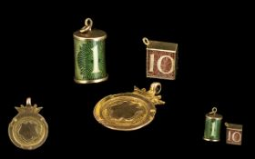 A Gold ' 10 Shillings ' Charm, A Good ' 10 ' bob Charm and a Gold Blank '1902 ' Fob.