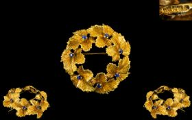 18ct Gold Stylised & Signed Leaf/Garland Brooch of round form set with sapphires.