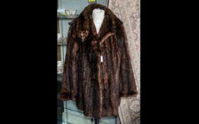 Ladies Mink Jacket. Hip length, hook and