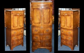 A Modern 20thC Mahogany Bow Fronted Cocktail Cabinet,