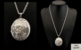 Silver Statement Locket And Chain.