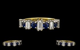 18ct Yellow Gold Attractive Baguette Cut Diamond and Sapphire Set Ring. Good design /setting.