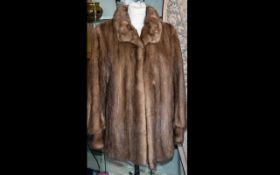 A Ladies Medium Brown Mink Jacket label to interior reads 'S.