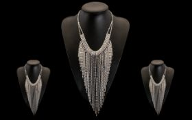 Aurora Borealis Crystal Long Fringe Necklace, a fully articulated, graduating, V shaped fringe of AB