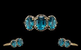 Ladies 9ct Gold Attractive 3 Stone Blue Topaz and Diamond Set Dress Ring - the blue topazes of