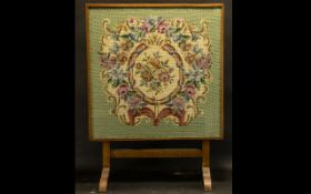 Victorian Tapestry Fire Screen raised on two arched feet, with swivel top.