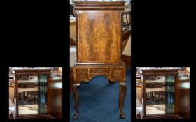 An Early 20thC Walnut Queen Anne Style Designed Cocktail Cabinet in the form of a tallboy.