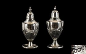 Walker & Hall Pair of Silver Pepperettes of Ribbed and Waisted Form.