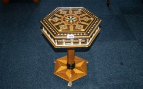 A Small Italian Occasional Table with parquetry inlay and North African design frieze modelled in