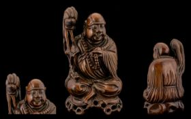 Japanese Late 19thC Superior Quality Hardwood Carving of a Seated Holy Man with Beard and Staff in