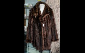 Ladies Mink Jacket. Hip length, hook and eye fastening, two slit pockets, revere collar and long
