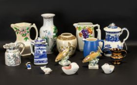 An Assorted Collection of Ceramics to include Rington's Mailing Ware leaf and berry jug,