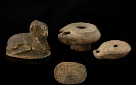 Archaeology Egyptian Interest To Include Two Stone Oil Lamps And A Small Sphinx Carving,