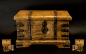 Vintage Solid Wooden Chest in Rustic style, with metal decorative strapping and two hinged handles.