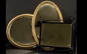 A Collection of Three Mirrors - to include 2 oval gilt mirrors, 1 square metal mirror with two black
