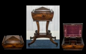 A Victorian Teapoy in rosewood. The top opens to reveal a sectioned interior and two mixing bowls