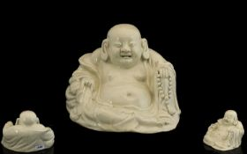 Chinese Sitting Buddha. Antique Chinese Buddha in off white porcelain, age related crazing, 5 inches
