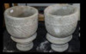 Two Mayan Urns - circular planter decorated with Aztec design on circular base.