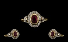18ct Gold Oval Shaped Diamond and Ruby Set Cluster Ring - of attractive form.