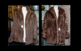Two Ladies Medium Brown Fur Coats compri