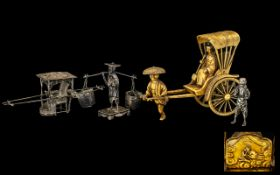 Two Chinese Silver Export Figural Groups depicting a Rickshaw with single figure and a trader
