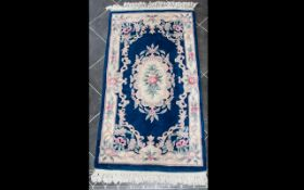 Wool Rug with blue ground and cream border with traditional floral and foliate detail with central