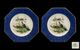 Two Vintage Wedgwood Plates decorated with peacocks, with blue and gilt trim. Please see images.