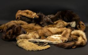 A Collection of Furs to include a ranch piece dark brown mink hat, various other fur hats, full