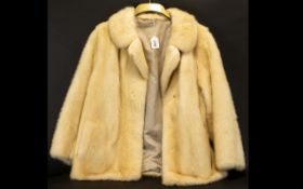 Ladies Blonde Mink Jacket hip length, approx size 12. Collar and reveres. Hook and eye fastening,