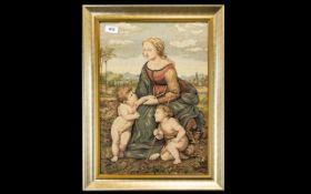 Vintage Tapestry Picture depicting a mother and two small boys with a village in the background.