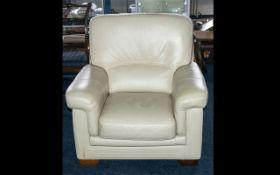 A Modern Contemporary Cream Leather Single Arm Chair.