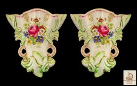 Two Vintage Wedgwood Ceramic Wall Sconces with floral decoration and gilt trim. In good condition,