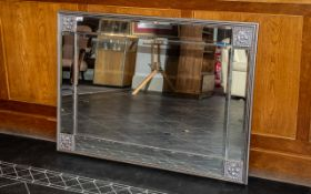 A Large Contemporary Over Mantle Mirror . With chrome coloured frame and panelled edges with