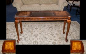 A Modern Lacquered Walnut Side Table - central glass panel raised on cabriole legs with shell carved