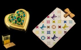 Louis Vuitton Handbag Mirror with pouch together with a Yves Saint Laurent Jewelled Heart Shaped