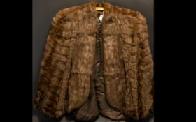Ladies Mink Cape chestnut brown, fully lined in sateen, with tie to front. Approx size 12/14. Please