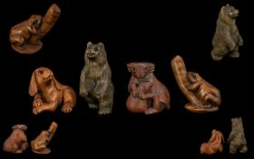 Four Japanese Boxwood Netsuke To Include A Bear, Dog, Frog And Water Buffalo Tallest 5cm. Three