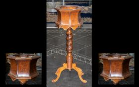 A Mid 20thC Wooden Jardiniere/ Plant Stand with an octagonal waisted top on a turned support with