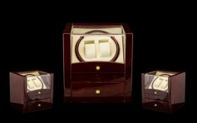Twin Automatic Watch Winder in polished wooden case with drawer beneath for watches, and brass