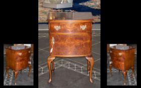 Small Mahogany Cabinet raised on four cabriole legs. Top drawer with brass handles, with a