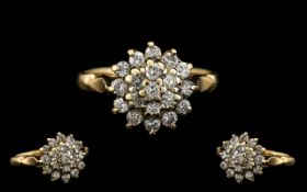9ct Gold Diamond Set Cluster Ring. Flowerhead setting, fully hallmarked for 9.375. The diamond of