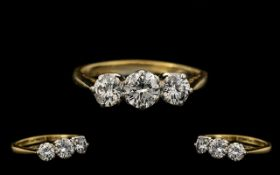 18ct Gold & Platinum Three Stone Diamond Ring of Pleasing Form marked 18ct and platinum. The