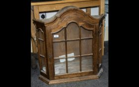 Oak Wall Mounted Bow Front Display Cabinet with glass front and three interior shelves. Arched top