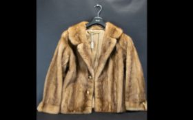 Blond Mink Jacket with collar and reveres, with hook and eye fastening and two side slit pockets.