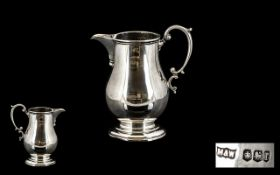 Mappin & Webb Sterling Silver Helmet Shaped Milk Jug of Small Proportions and Pleasing Form.