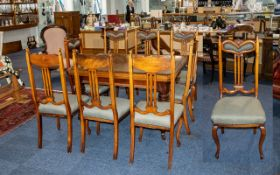 A Set of Eight Dining Chairs with green upholstered seat and head rest. With splayed lays and