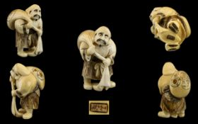 Japanese - Mid 19th Century Signed Well Carved Ivory Netsuke Depicts a Male Figure Carrying a