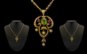 Art Nouveau 15ct Gold Peridot Ruby and Seed Pearl Pendant of Wonderful Form In The Suffragette